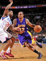 Shannon Brown drives against Willie Green.JPG