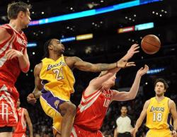 Josh Powell battles for the ball against Chase Budinger.JPG