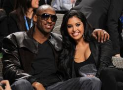 Vanessa Bryant smiles in a black top with Kobe Bryant.JPG