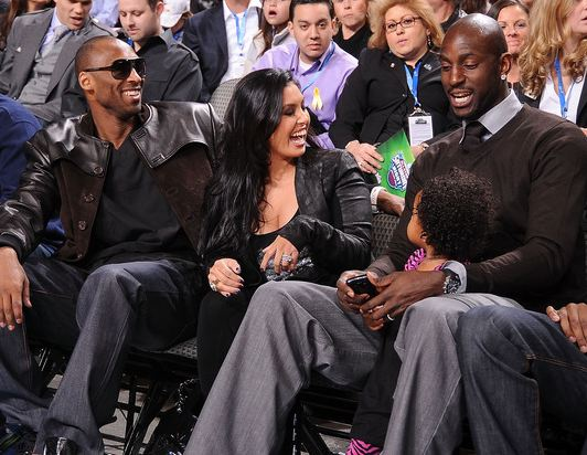 Vanessa Bryant laughs as she sits next to Kobe Bryant and Kevin Garnett during the NBA All Star festivities.JPG