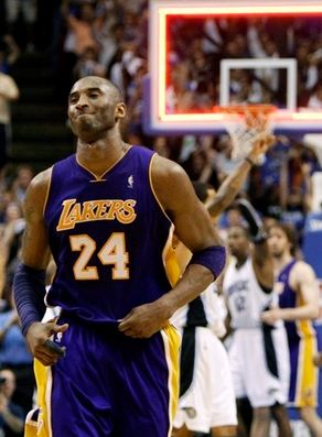 Kobe Bryant walks off the court after missing his last