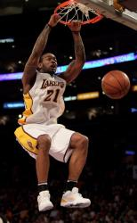 Josh Powell 2 handed power dunk in a white Lakers jersey.JPG