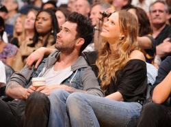 Laker fan Adam Levine and girlfriend attend a Laker game at Staples Center.JPG
