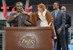 Marge Hearn touches the Chick Hearn statue with Rick Fox and Stu Lance nearby.JPG