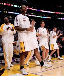 Josh Powell and the Laker bench celebrate a play in game 1 vs the Jazz 2010.JPG