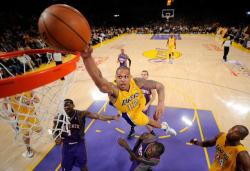 Shannon Brown jumps over Jason Richardson in a dunk attempt as Kobe Bryant goes woo.JPG