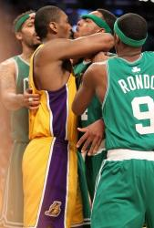 Ron Artest gets up close and personal with Paul Pierce.JPG