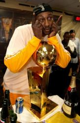 DJ Mbenga poses with the Lakers 2010 NBA Championship trophy.JPG
