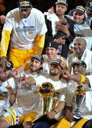Laker teammates hold up their index finger as they pose together during the 2010 NBA championship trophy presentation.JPG