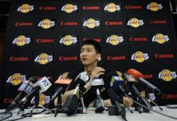 Sun Yue fields questions during his Laker press conference.jpg