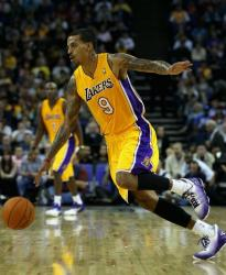 Matt Barnes drives the ball during the first Laker preseason game 2010.JPG