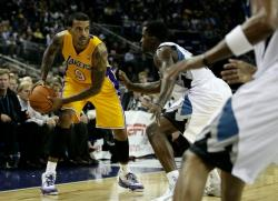 Matt Barnes looks to pass the ball during the first Laker preseason game 2010.JPG