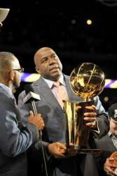 Magic Johnson holds the Lakers 2009-2010 NBA Championship trophy.JPG