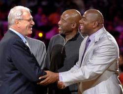 Magic Johnson smiles and talks to Phil Jackson.JPG