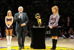 Jeanie Buss next to David Stern during the Lakers 2010 Championship ring ceremony on opening night.JPG