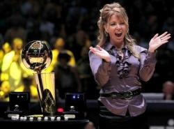 Jeanie Buss claps her hands during Lakers opening night 2010.JPG