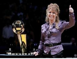 Jeanie Buss gives the thumbs up next to the Lakers 2009-2010 championship trophy.JPG
