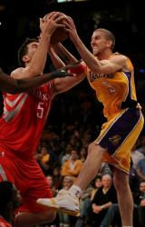 Steve Blake bares his teeth and looks fierce as he battles for the rebound vs the Rockets.JPG