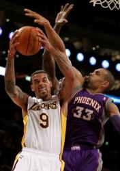 Matt Barnes is challanged by Grant Hill.JPG