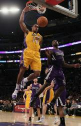 Shannon Brown right handed power dunk as Tyreke Evans looks on.JPG