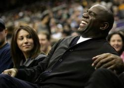 Magic Johnson has a laugh as he watches a Lakers Nets game.JPG