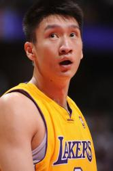 Sun Yue looks on in a Lakers uniform.jpg