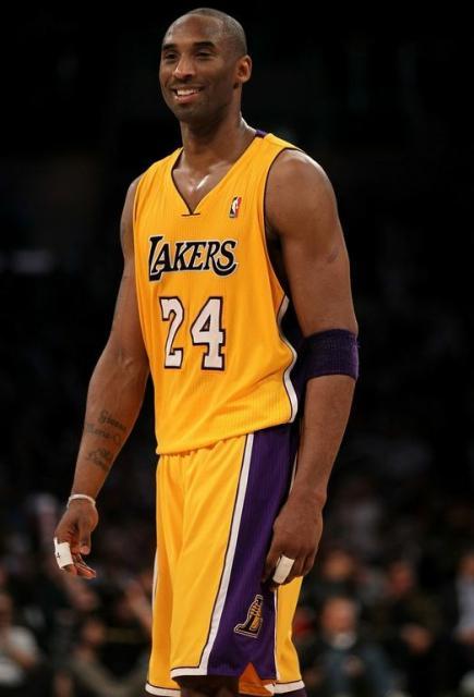 01fea4e25 Kobe Bryant smiles in a Lakers 24 home uniform.JPG