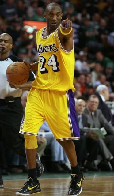 Kobe Bryant directs traffic in a yellow Lakers vintage ...