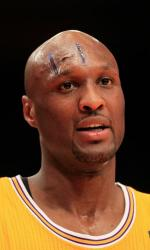 Lamar Odom with a clear bandage on his forehead.JPG