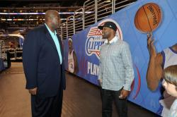 Magic Johnson talks to Baron Davis before the game.jpg