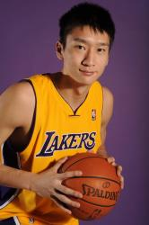 Sun Yue holds the ball in a portrait shot.jpg
