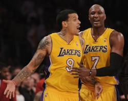 Matt Barnes is restrained by Lamar Odom.JPG