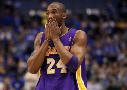 Kobe Bryant covers his mouth with both hands.JPG