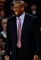 Brand new Los Angeles Lakers head coach Mike Brown laughs in a black suit.JPG