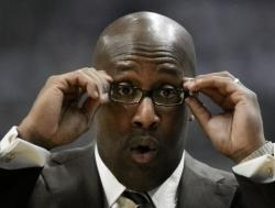 Mike Brown adjusts his glasses and makes an o-shape with his mouth.JPG