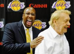 Mike Brown laughs as he puts his hand on Jerry Buss' shoulder.JPG