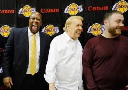 Mike Brown laughs as Jerry Buss and Jesse Buss smile.JPG