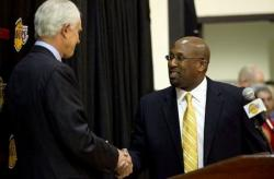 Mike Brown shakes hands with Mitch Kupchak.JPG