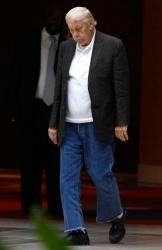 Jerry Buss in black jacket and jeans after a meeting with fellow NBA owners.JPG