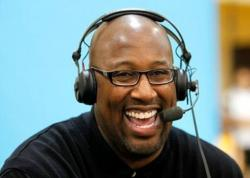 Mike Brown laughs with a headset on.JPG