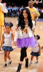 Vanessa Bryant in a Laker jersey and her two daughers with Kobe Bryant at Staples Center.JPG
