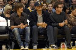 Laker fans Leonardo DiCaprio sits with Zac Efron and Kevin Connolly.jpg