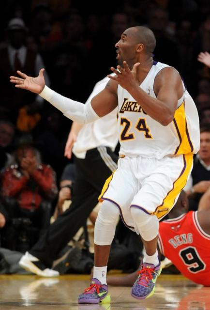 official photos 42493 0da13 Kobe Bryant gestures with both hands in a white Laker jersey ...