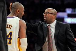 Mike Brown pats Kobe Bryant in the back of the head.JPG