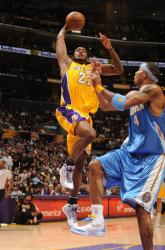 Josh Powell elevates against Kenyon Martin.jpg