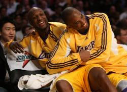 Kobe Bryant and Lamar Odom has a big laugh on the bench.jpg
