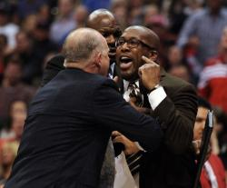 Mike Brown is upset at the referees and have to be restrained.JPG