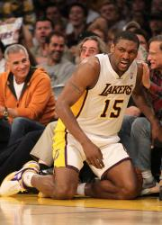 Metta World Peace kneels on the floor out of bounds next to Staple Center courtside seats.JPG