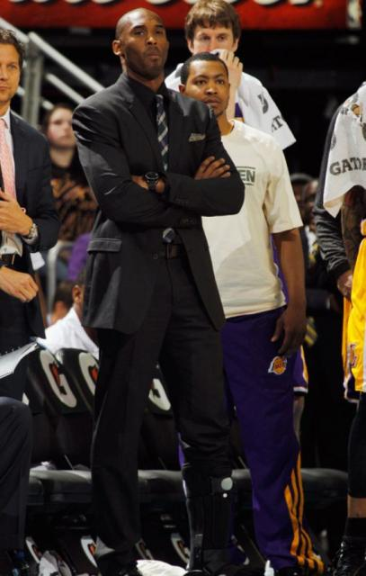 Kobe Bryant Looks On Arms Folded While Wearing A Black Suit Jpg