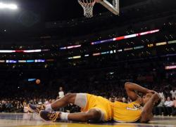 Ramon Sessions lays on the floor grabbing his head no believing he was called for a foul.JPG